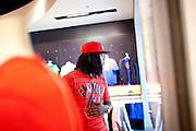 Rapper Waka Flocka picks up a pair of Nikes at Lenox Square Mall in Atlanta, Georgia August 17, 2010.