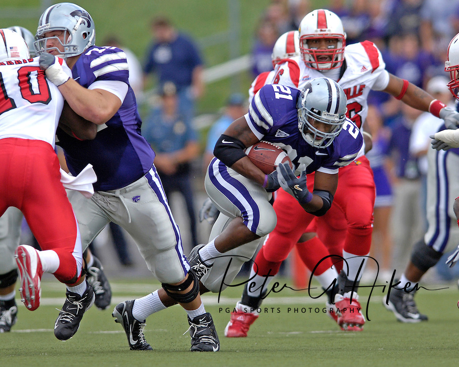 Kansas State running back Carlos Alsup (21) brakes through a hole against Louisville in the first half at Bill Snyder Family Stadium in Manhattan, Kansas, September 23, 2006.  The 8th ranked Louisville Cardinals beat K-State 24-6.