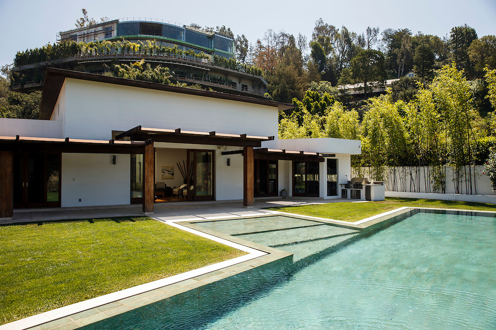 The mansion of Mohamed Hadid under construction at 901 Strada Vecchia stands above the home of Joseph Horacek in the Bel Air neighborhood of Thursday, July 16, 2015 in Los Angeles, California. Photo by Patrick T. Fallon for DailyMail.com
