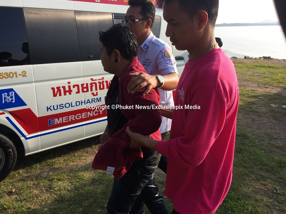 "SHOCKING picture shows emergency personnel save girl after she walked into the sea following an argument with her partner. <br /> <br /> A woman narrowly escaped drowning early this morning after she walked into the sea at Saphan Hin following an argument with her girlfriend.<br /> <br /> Lt Col Pongpichan Chayanonpiriya of Phuket City Police received reports of the incident at about 6:30am.<br /> <br /> ""We found a young woman at the scene, crying and calling out for 'Jip'. After searching the area for 30 minutes, rescue workers found the young woman on a broken old boat nearby,"" said Col Pongpichan.<br /> <br /> Jip's girlfriend, whose name was withheld by police, said that the two of them had driven up to Saphan Hin and parked nearby to talk. They began arguing, after which Jip got out of the car and ran into the sea.<br /> <br /> ""Jip, after being rescued, told police that she was very angry with her girlfriend. She had walked about 200 meters from the shore when she got caught in some waves and was swept out. She also said that if it weren't for the boat, she would've ended up dead,"" said the colonel.<br /> <br /> She was taken to Vachira Phuket Hospital for treatment.<br /> ©Phuket News/Exclusivepix Media"
