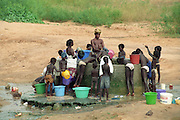 Women and children washing at at a local well - Senegal
