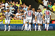 Picture by Paul Chesterton/Focus Images Ltd.  07904 640267.11/9/11.Peter Odemwingiea of West Brom opens the scoring and celebrates during the Barclays Premier League match at Carrow Road stadium, Norwich.