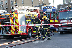 © Licensed to London News Pictures. 30/06/2018. London, UK.  Fire Brigade at the scene in Creek Road, Greenwich where a crane caught fire this evening.  Photo credit: Vickie Flores/LNP