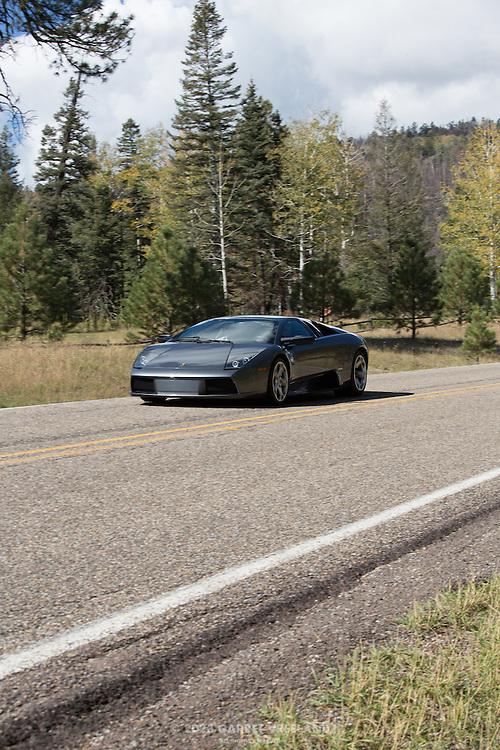 2004 Lamborghini Murceilago flashes past, on the 2012 Santa Fe Concorso High Mountain Tour.
