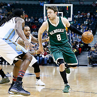 03 February 2016: Milwaukee Bucks guard Matthew Dellavedova (8) drives past Denver Nuggets guard Jameer Nelson (1) and faces Denver Nuggets forward Kenneth Faried (35) during the Denver Nuggets 121-117 victory over the Milwaukee Bucks, at the Pepsi Center, Denver, Colorado, USA.