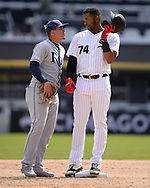 CHICAGO - APRIL 09:  Eloy Jimenez #74 of the Chicago White Sox talks to Willy Adames #1 of the Tampa Bay Rays on April 9, 2019 at Guaranteed Rate Field in Chicago, Illinois.  (Photo by Ron Vesely)  Subject:   Eloy Jimenez; Willy Adames