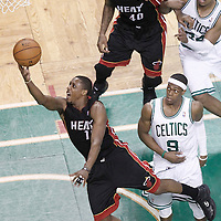03 June 2012: Miami Heat point guard Mario Chalmers (15) goes for the layup past Boston Celtics point guard Rajon Rondo (9) during the Boston Celtics 93-91 overtime victory over the Miami Heat, in Game 4 of the Eastern Conference Finals playoff series, at the TD Banknorth Garden, Boston, Massachusetts, USA.