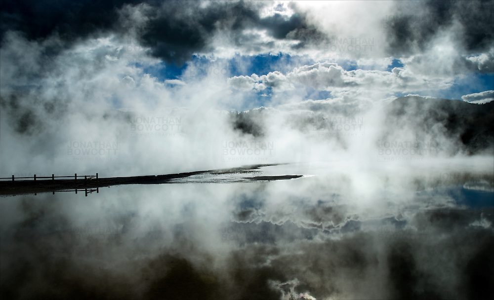 Steam and cloud formations at thermal Lake, Wai-O-Tapo geothermal reserve, New Zealand