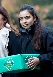© Licensed to London News Pictures. 12/12/2017. London, UK. A former Grenfell Tower resident (who does not want to be named) hands a petition in at Downing Street, calling for the public inquiry into the disaster to be overhauled. This includes having a panel from a diverse range of backgrounds installed alongside Sir Martin Moore-Bick, the retired Court of Appeal judge leading the process. Photo credit : Tom Nicholson/LNP