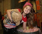 Ten year old Abbie Cook from Cupar tries her hand at the lucky dip  - Dundee United open day at Tannadice<br /> <br />  - Pictures © David Young