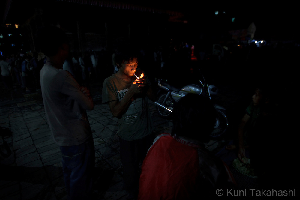 Buddhi lights up a cigarette in Kathmandu, Nepal on Aug 21, 2012..There are estimated around 5,000 street children working and living on the streets of Nepal and the number continues to grow with roughly 300 to 500 children leaving home every year. Some do so because of abusive, alcoholic parents, maltreatment at home, and the temptation to earn more money. They often end up taking drugs, abusing alcohol, and even suffering sexual abuse by locals and foreign tourists..(Photo by Kuni Takahashi)