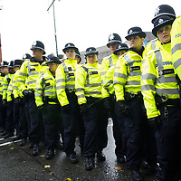 Legions of police overseed an estimated 5,000 protestors marched the streets of Birmingham to voice their opposition of Prime Minister David Cameron and the Conservatives on the first day of party conference at the ICC, Birmingham, UK on October 3, 2010.  This is the first conference since the government coalition with the Liberal Democrats.