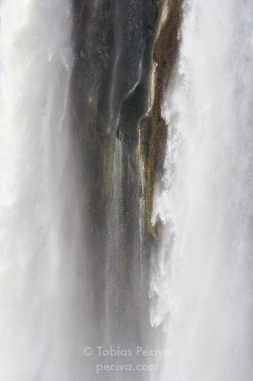Section of the Devil's Throat waterfall (Garganta del Diablo, Garganta do Diabo) at Iguazu Falls. Iguazu Falls straddle the border between Argentina and Brazil.