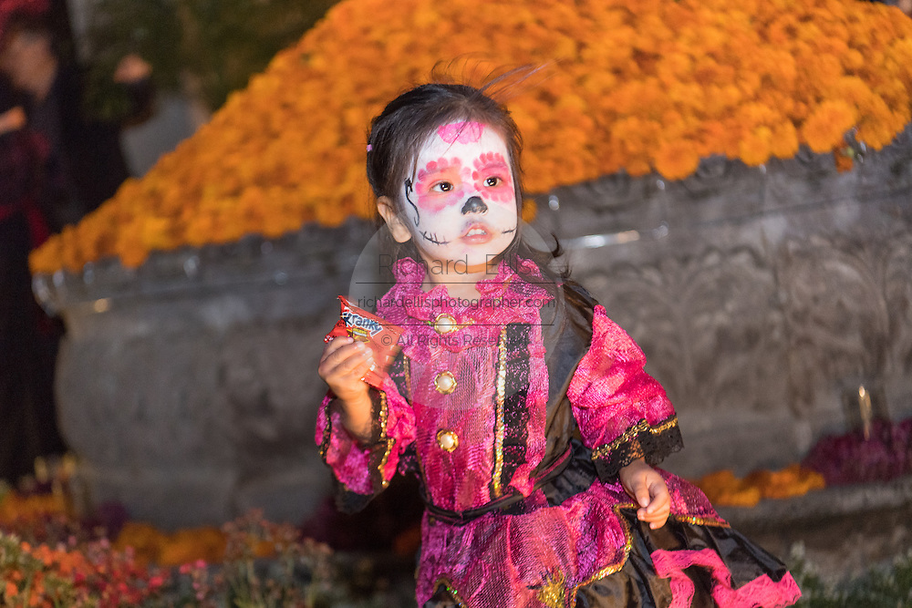 A little girl dressed as La Calavera Catrina during the Day of the Dead festival November 1, 2016 in San Miguel de Allende, Guanajuato, Mexico. The week-long celebration is a time when Mexicans welcome the dead back to earth for a visit and celebrate life.