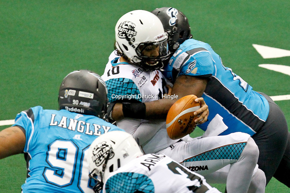 August 10, 2012; New Orleans, LA, USA; Arizona Rattlers quarterback Nick Davila (10) is sacked by Philadelphia Soul defensive lineman Bryan Robinson (12) during the second quarter of the ArenaBowl XXV at the New Orleans Arena Mandatory Credit: Derick E. Hingle-US PRESSWIRE