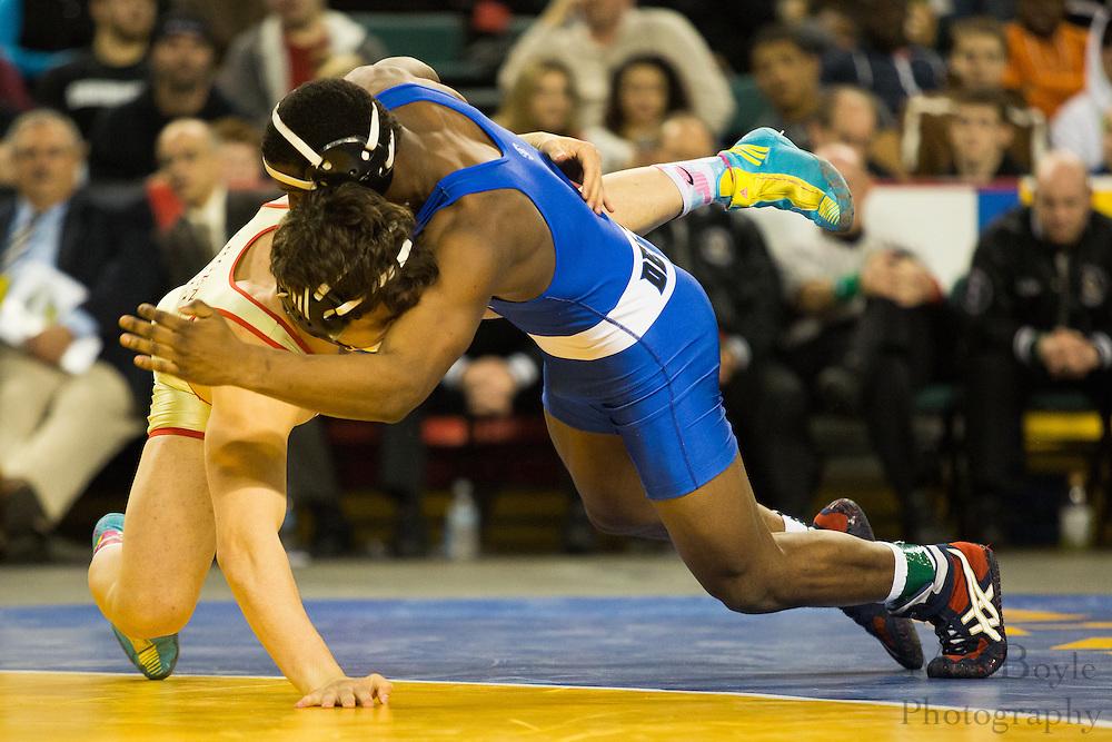 Johnny Sebastian of Bergen Catholic defeats David Williams of Hammonton (Blue) during the 182 lb NJ individual state wrestling final held at Boardwalk Hall in Atlantic City on Sunday March 9, 2013. (photo / Mat Boyle)