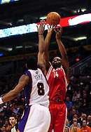 Jan. 6 2010; Phoenix, AZ, USA; Houston Rockets forward Carl Landry (14) puts up a shot against the Phoenix Suns center Channing Frye (8) at the US Airways Center. Phoenix Suns defeated the Houston Rockets 118-110. Mandatory Credit: Jennifer Stewart-US PRESSWIRE