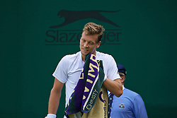 LONDON, ENGLAND - Tuesday, June 28, 2016: Tomas Berdych (CZE) wipes his face with a Wimbledon towel during the Gentlemen's Singles 1st Round match on day two of the Wimbledon Lawn Tennis Championships at the All England Lawn Tennis and Croquet Club. (Pic by Kirsten Holst/Propaganda)