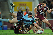 May 25th 2011: Kade Snowden of the Blues dives on the loose ball during game 1 of the 2011 State of Origin series at Suncorp Stadium in Brisbane, Australia on May 25, 2011. Photo by Matt Roberts/mattrIMAGES.com.au / QRL