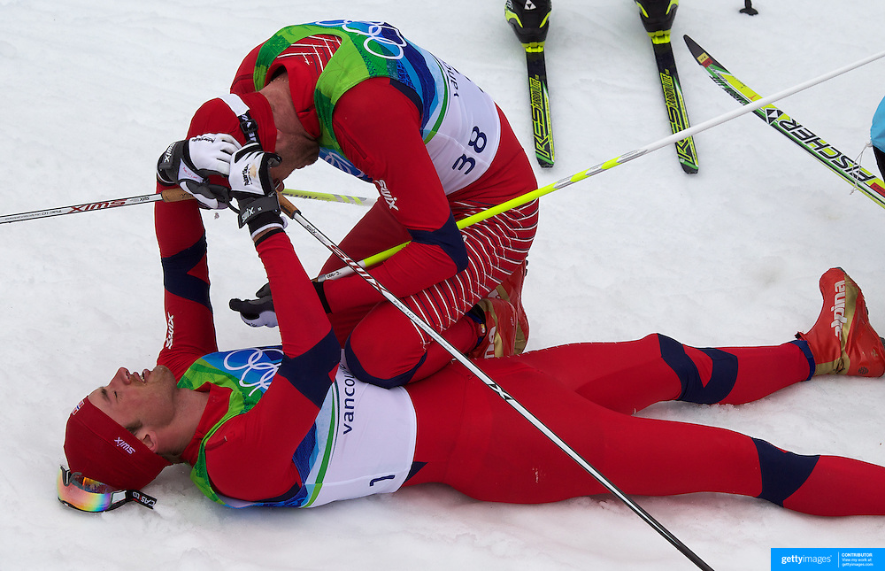 Winter Olympics, Vancouver, 2010.Petter Northug, Norway, Winning the Gold Meda is congratulated by team mate Odd-Bjoern Huelmeset (38) in the Cross Country Skiing, Men's 50 KM Mass start at Whistler Olympic Park, Whistler, during the Vancouver Winter Olympics. 28th February 2010. Photo Tim Clayton