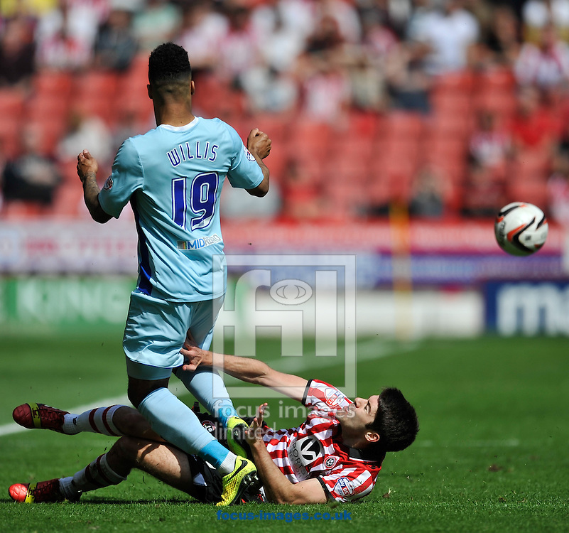 Ryan Flynn of Sheffield United slides in on Jordan Willis of Coventry City during the Sky Bet League 1 match at Bramall Lane, Sheffield<br /> Picture by Richard Land/Focus Images Ltd +44 7713 507003<br /> 03/05/2014