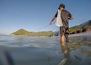 Fishermen fishing at Choeng mon beach, Koh Samui, Thailand