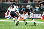 DeAndre Washington (RB) of the Oakland Raiders looks to pass Danny Trevathan (LB) of the Chicago Bears during the International Series match between Oakland Raiders and Chicago Bears at Tottenham Hotspur Stadium, London, United Kingdom on 6 October 2019.