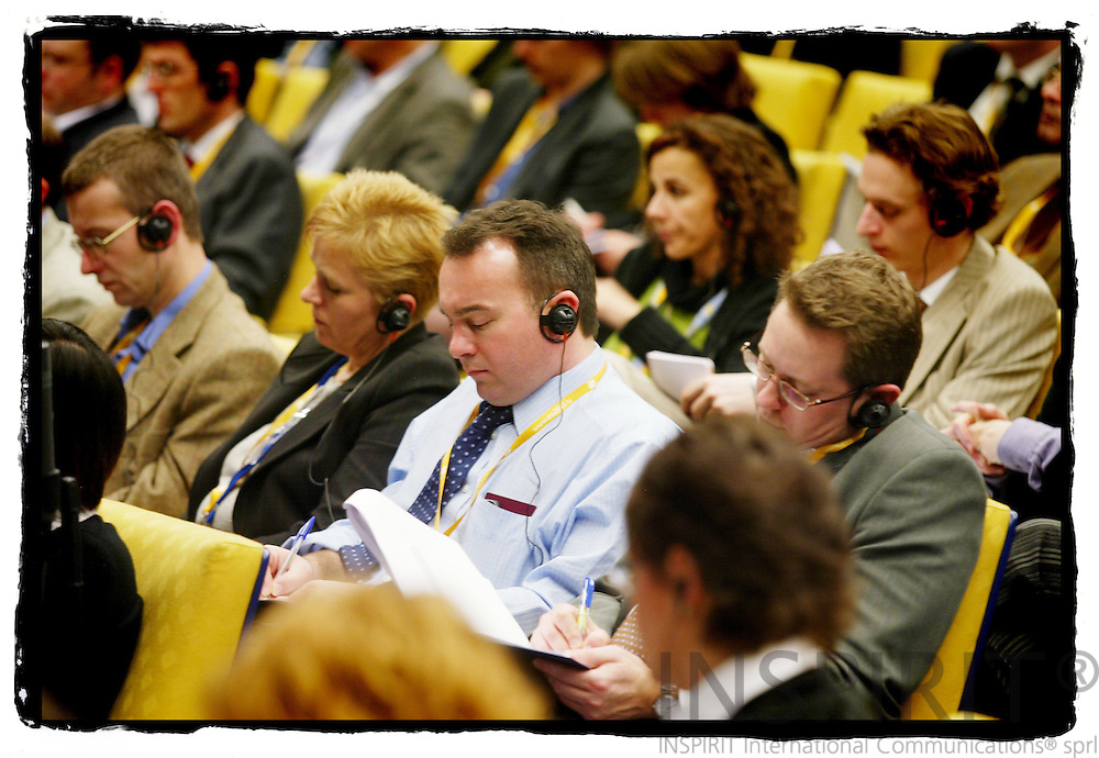 BRUSSELS - BELGIUM - 22 MARCH 2005 --Journalists taking notes during a press conference in the EU Council Summit.--  PHOTO: ERIK LUNTANG / INSPIRIT Photo
