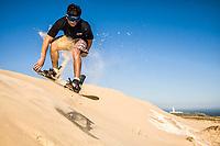 Sandboarding on the dunes of Cape of Santa Marta. Laguna, Santa Catarina, Brazil. / <br /> Sandboard nas dunas do Cabo de Santa Marta. Laguna, Santa Catarina, Brasil.