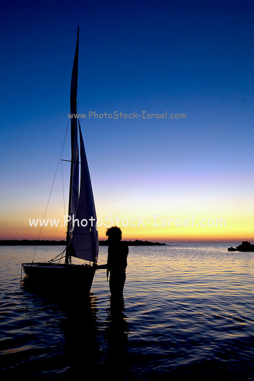 Sailboats at sunset in the Mediterranean Sea
