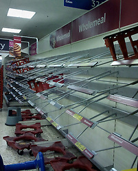 © Licensed to London News Pictures. 04/02/2012. Empty bread shelves at a Tesco supermarket in Edgington Way, Sidcup. Bad weather and heavy snowfall are forecast for much of the UK over the next 24hrs. Photo credit : Grant Falvey/LNP