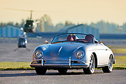 Image of a custom silver sports car with helicoptors, 1958 Porsche 356 Speedster in Washington state, Pacific Northwest, property released