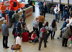 Stranded passengers wait to rebook flights at Schiphol Airport in Amsterdam, the Netherlands, on Tuesday, April 20, 2010. (Photo © Jock Fistick)