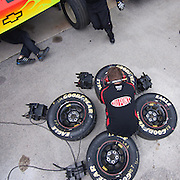 NASCAR Jeff Gordon crew member sitting on a set of tires Friday, May. 13, 2011 during NASCAR Sprint Cup Series practice race at Dover International Speedway in Dover Delaware.