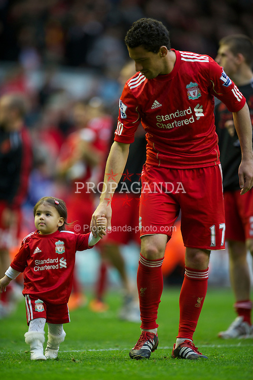 LIVERPOOL, ENGLAND - Sunday, May 15, 2011: Liverpool's Maximiliano Ruben Maxi Rodriguez with his child during the Premiership match against Tottenham Hotspur at Anfield. (Photo by David Rawcliffe/Propaganda)