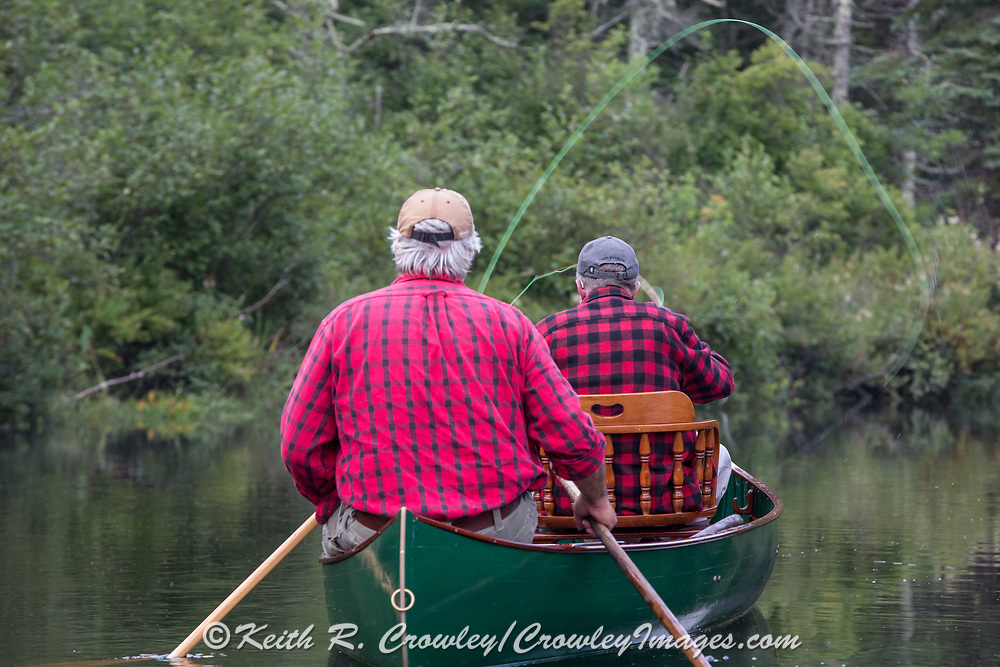 Brule River fishing guide Damian Wilmot (left) paddles the upper Brule with angler Matson Holbrook in a 1895 Joe Lucius guide canoe Wilmot meticulously restored over the course of two years.