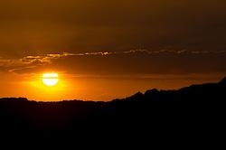 Sunset over the dunes at Burnham Overy Staithe, North Norfolk Coast, England, UK.