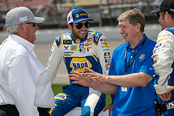 August 12, 2018 - Brooklyn, MI, U.S. - BROOKLYN, MI - AUGUST 12: Car Owner Rick Hendrick (left), Monster Energy NASCAR Cup Series driver Chase Elliott (9) and his father Bill Elliot share a laugh before the Monster Energy NASCAR Cup Series Consumers Energy 400 at Michigan International Speedway on August 12, 2018 in Brooklyn, Michigan.(Photo by Adam Lacy/Icon Sportswire) (Credit Image: © Adam Lacy/Icon SMI via ZUMA Press)