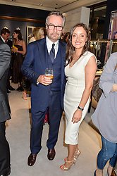 BRIAN DUFFY CEO of Mappin & Webb and ELIZABETH GALTON Creative Director of Mappin & Webb at a party to celebrate the opening of Mappin & Webb's Flagship Regent Street Boutique at 132 Regent Street, London on 28th June 2016.