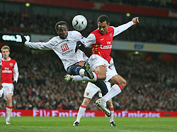 LONDON, ENGLAND - Wednesday, January, 9th, 2007: Arsenal's Gilberto and Tottenham Hotspur's Pascal Chimbonda during the League Cup Semi-Final 1st Leg match against Arsenal at the Emirates Stadium. (Pic by Chris Ratcliffe/Propaganda)