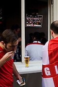 England World Cup football fans watch their team's opening match on TV in Soho.