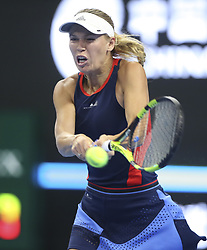 BEIJING , Oct. 1, 2018  Caroline Wozniacki of Denmark hits a return during the women's singles first round match against Belinda Bencic of Switzerland at China Open tennis tournament in Beijing, China, Oct. 1, 2018. (Credit Image: © Song Yanhua/Xinhua via ZUMA Wire)