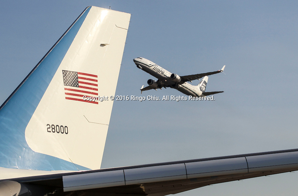 An Alaska Airline aircraft flies past Air Force One sitting on the tarmac before President Barack Obama boarding at Los Angeles International Airport in Los Angeles, Friday, Feb 12, 2016.(Photo by Ringo Chiu/PHOTOFORMULA.com)<br /> <br /> Usage Notes: This content is intended for editorial use only. For other uses, additional clearances may be required.
