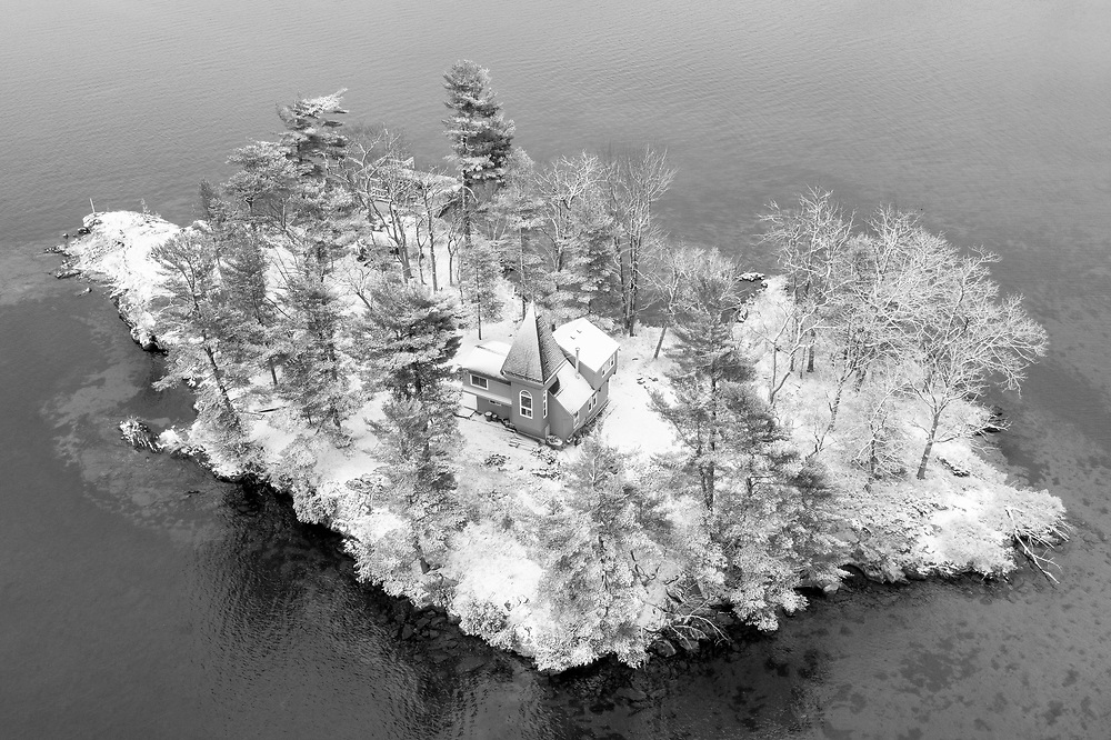 https://Duncan.co/snow-covered-cottage-with-spire-on-small-island