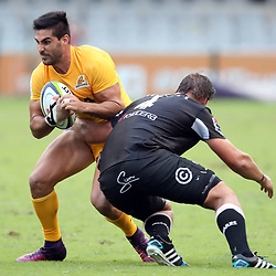 Etienne Oosthuizen of the Cell C Sharks looks to tackle Jeronimo de la Fuente of the Jaguares during the Super Rugby match between the Cell C Sharks and the Jaguares  April 8th 2017 - at Growthpoint Kings Park,Durban South Africa Photo by (Steve Haag Sports)