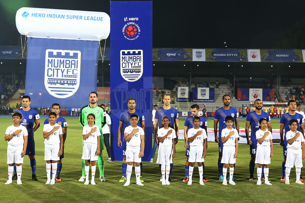 Mumbai City FC players during national anthem  during match 7 of the Indian Super League (ISL) season 3 between Mumbai City FC and NorthEast United FC held at the Mumbai Football Arena in Mumbai, India on the 7th October 2016.<br /> <br /> Photo by Faheem Hussain / ISL/ SPORTZPICS
