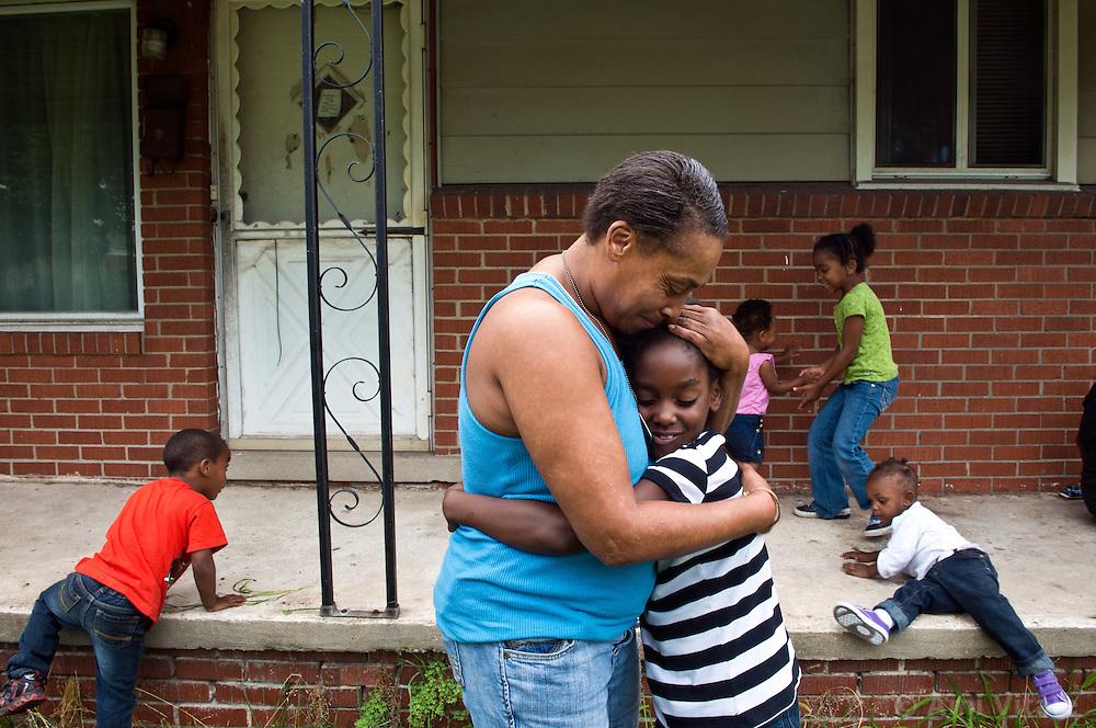 Siobhan Washington hugs her granddaughter Marianne Hildreth, 7,  as the rest of her grand children play in the background. in River Rouge, Detroit, near a DTE coal plant August 13, 2012.
