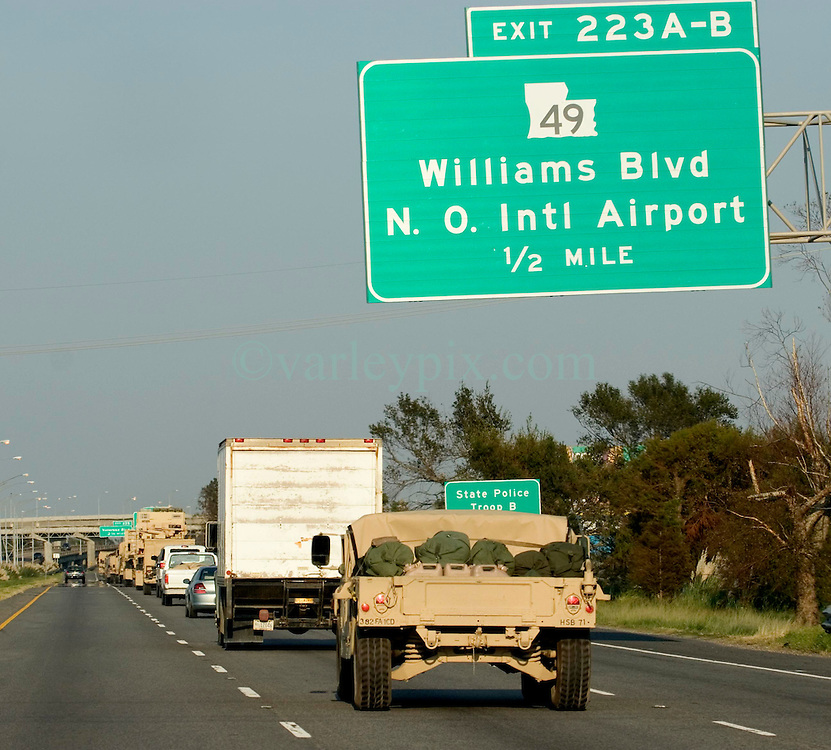 06 Sept, 2005. New Orleans, Louisiana. Hurricane Katrina aftermath. <br /> <br /> Military convoys finally stream down I-10, days after the catastrophic storm smashed New Orleans.<br /> Photo; &copy;Charlie Varley/varleypix.com