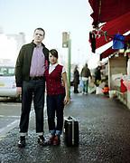 Couple with Luggage, Dalston Market, London, UK, 1980s.