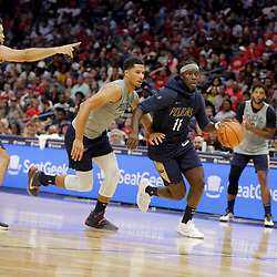 Oct 5, 2019; New Orleans, LA, USA; New Orleans Pelicans guard Jrue Holiday (11) drives past guard Josh Hart during a open practice at the Smoothie King Center. Mandatory Credit: Derick E. Hingle-USA TODAY Sports